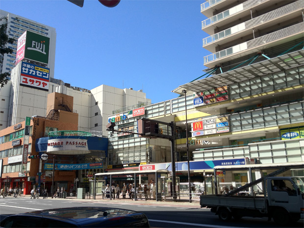 "The sight outside of Kamiooka Station. On the right side, the ""Camio"" mall. Just out of sight on the left side, the ""Mioka"" mall."